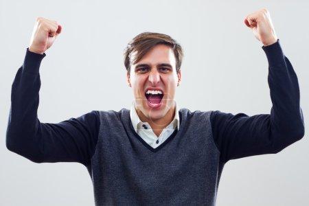 Photo pour Heureux jeune homme sur fond blanc - image libre de droit