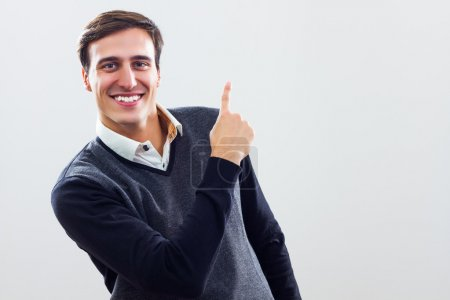 Photo for Businessman pointing at your product,Businessman pointing - Royalty Free Image
