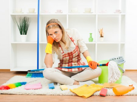 Photo for Young sad housewife is tired of cleaning - Royalty Free Image