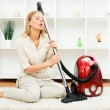 Portrait of beautiful housewife with vacuum cleane...