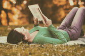 Woman is reading a book and enjoys in her free time