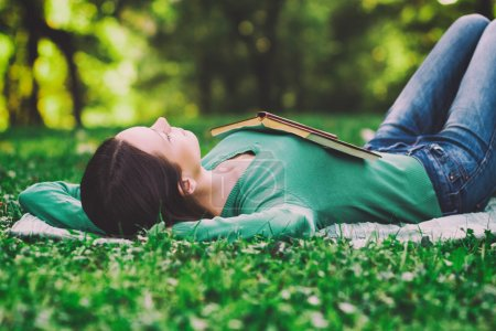 Photo for Young woman lying down in nature and sleeping,Resting in nature - Royalty Free Image