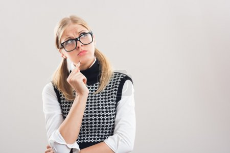 Nerdy woman is thinking about something