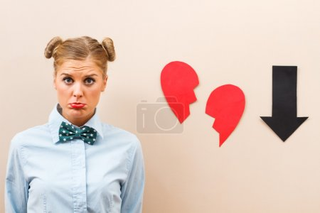Photo for Cute geek girl is sad because someone has broken her heart - Royalty Free Image
