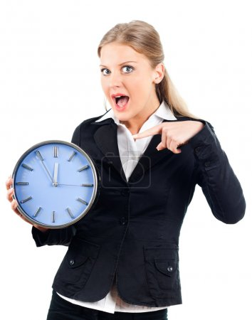 Beautiful businesswoman pointing at wall clock