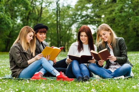 Girls sitting in the park and learning