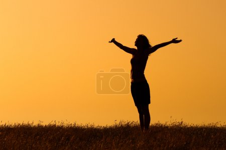woman enjoys in sunset
