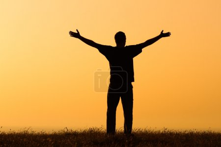Photo for Happy man enjoys in sunset. Greeting the sunset - Royalty Free Image