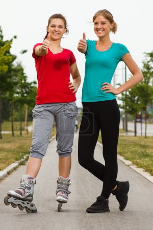 Sporty girls showing thumbs up