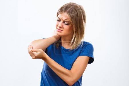 Young woman having elbow pain