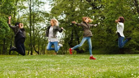 young girls having fun in park