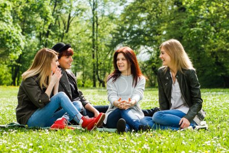 young girls talking in park