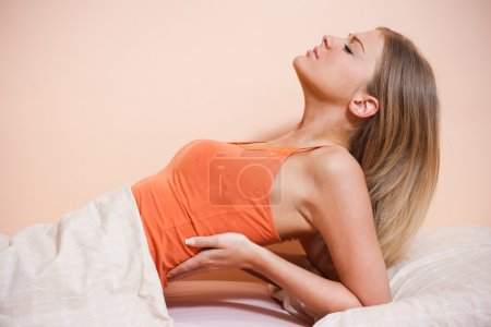 young woman having back pain