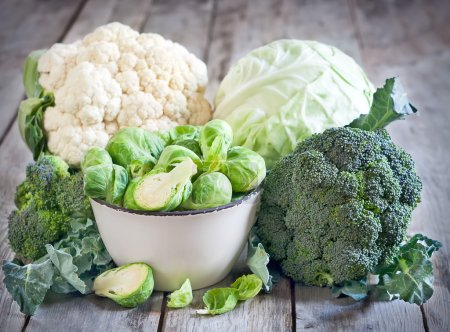 Photo for Assortment of cabbages on old wood background - Royalty Free Image