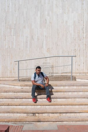 Photo for Young man sitting on the stairs. - Royalty Free Image