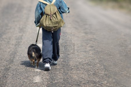 Young traveler on a trip with a dog