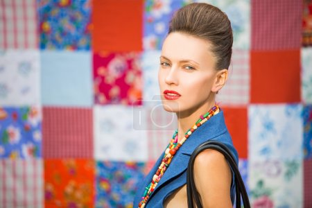 Photo for Fashion stylish woman wearing bright accessories over bright multicolored background - Royalty Free Image