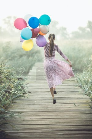 Beautiful woman with colorful balloons