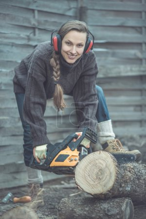 Woodworker with chainsaw