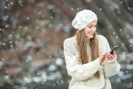 Young  woman smiling with smart phone