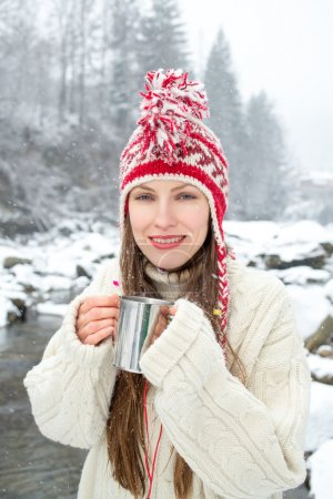 Photo for Winter portrait woman drinking hot tea over amazing snowy landscape - Royalty Free Image