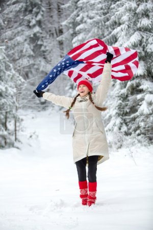 Patriotic young woman with the American flag