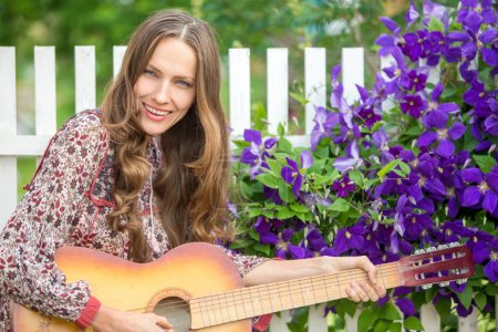 Country hippie girl with guitar