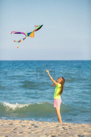 Photo for Woman with kite over  blue sea and sky. motion - Royalty Free Image