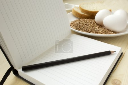 Photo for Keep a record of what you eat in a journal - Royalty Free Image