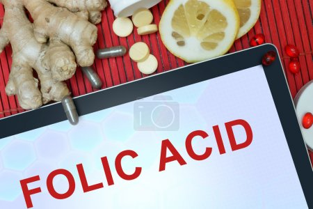 Tablet with words  Folic acid