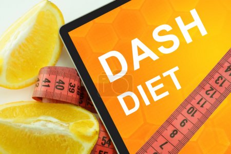 Dash diet on tablet. Fat lost concept....