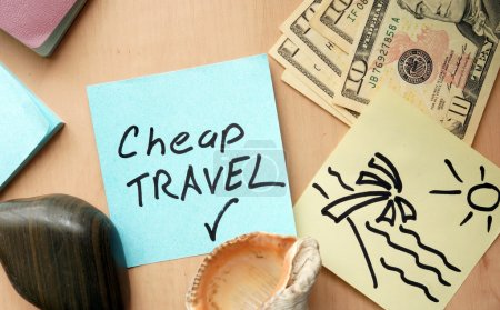 Photo for Cheap travel paper on a table with money - Royalty Free Image