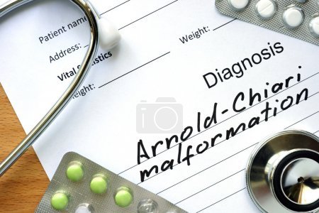 Diagnostic form with diagnosis Arnold-Chiari malformation and pills.