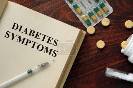 Diabetes symptoms  written on a book.