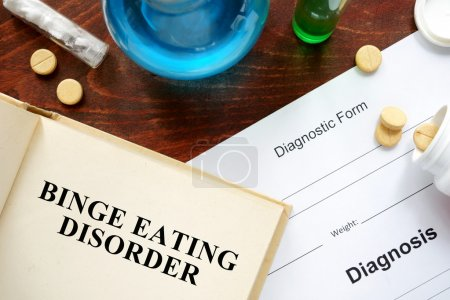 Photo for Binge eating disorder  written on a book and diagnosis form. Medical concept. - Royalty Free Image
