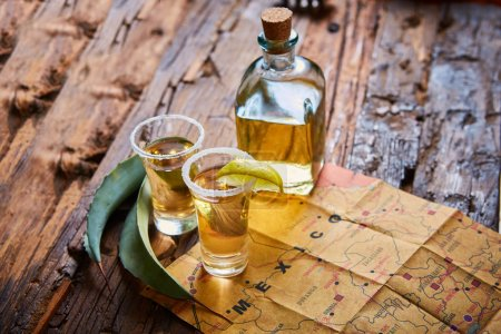 Photo for Tequila shot with lime and sea salt on wooden table, selective focus - Royalty Free Image