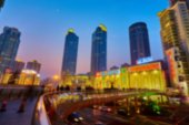 Shanghai skyline at night out of focus.