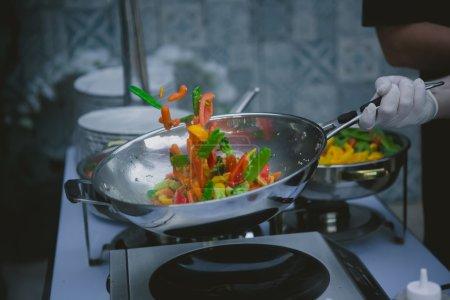 cooking vegetables in wok pan