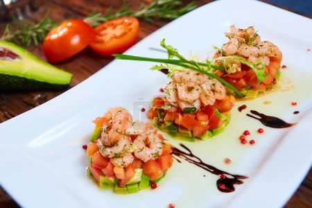 Photo for Salad with shrimps, tomato and avocado. Healthy food - Royalty Free Image
