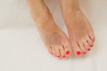 Photo for Pretty toes with red nail polish. Shallow dof - Royalty Free Image