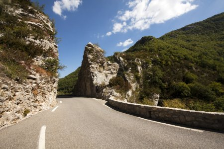 Road and rocks in a high mountain in France...