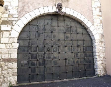 Ancient metal gate with helmet of medieval knight....