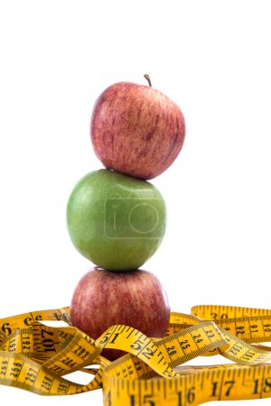 Apple and a measuring tape isolated on white background with clipping path