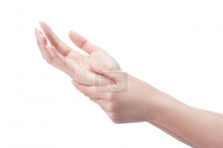 Acute pain in a woman palm, a woman massaging her painful hand.