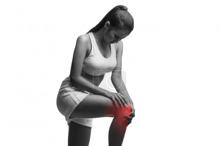 Woman having knee pain isolated on a white background with clipping path