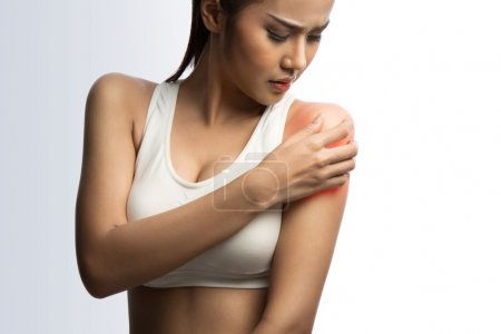 young muscular woman with shoulder pain, on white background with clipping path