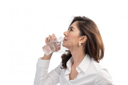 Beautiful business woman drinking water from bottle