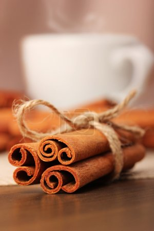 Cinnamon and beverage cup on wooden table series - 5
