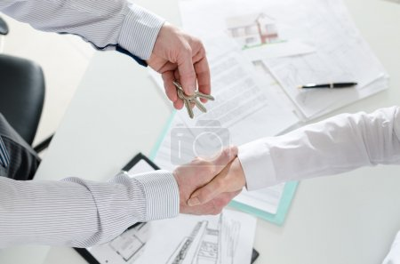 Realtor shaking hands with his client