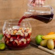 Preparation of sangria, on wooden background...